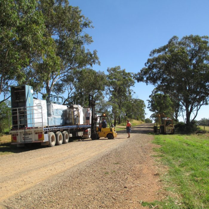 unloading another truck for the rosabella mill